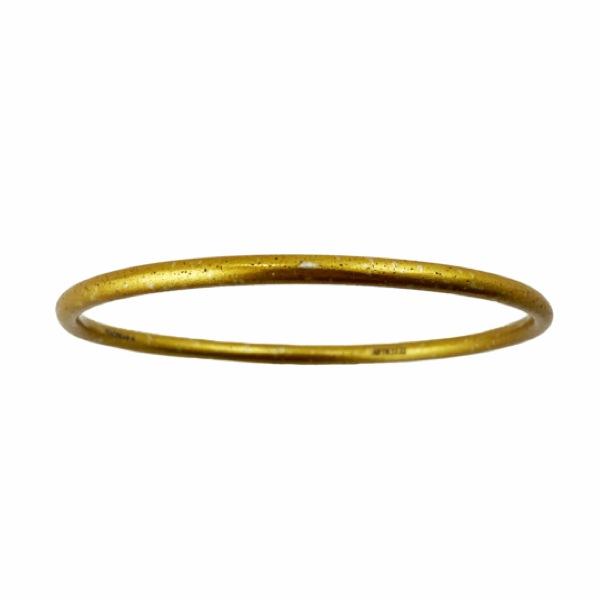 Gold tone skinny bangle