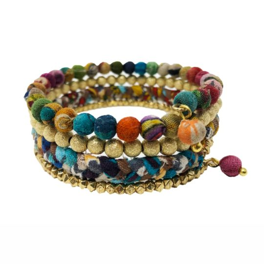 Hand-selected Kantha textile beads create a soft rainbow gradient in this wrap-around bracelet. Finished with brass teardrop charms.