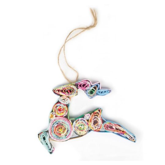 """This Recycled Paper Reindeer Ornament is handmade in Vietnam by artisans in a small cooperative called Tigerlily, which provides a fair, reliable income and safe and dignified work place. They roll recycled magazines around broom bristles and coat them with a non-toxic lacquer making it durable. No two ornaments are alike since each is uniquely handmade - colors will vary. Size: 4.7"""" x 3"""" Learn more about Acacia Creations and the artisans who make this product."""