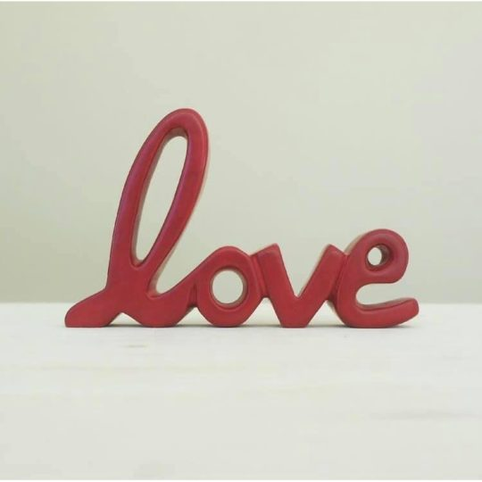 soapstone standing word love red